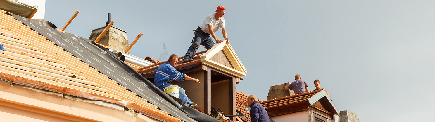 bigstock-Roofers-On-The-Roof-82670789-copy